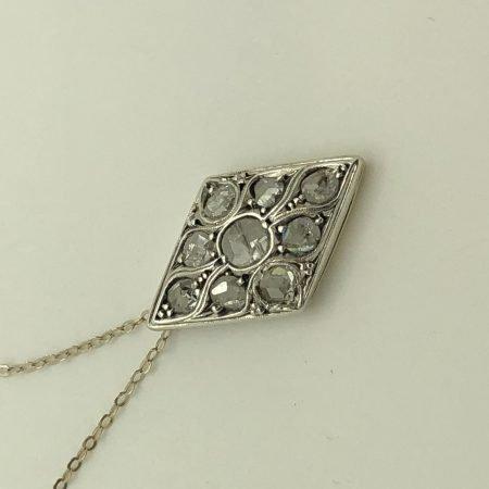 Diamond-shaped liberty pendant in silver gold and rose cut diamonds
