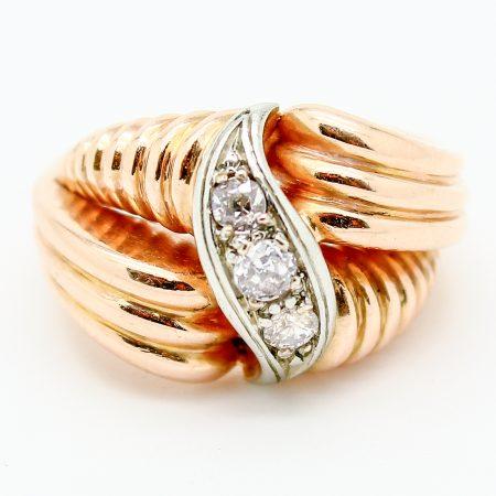 Anello fascia anni '40 in oro rosa oro bianco e diamanti taglio antico
