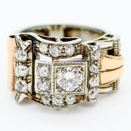 Anello Decò a forma di fibbia in oro e diamanti taglio antico