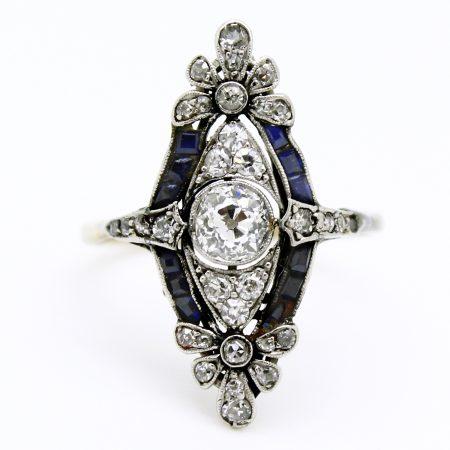 Anello Decò in platino forma marquise diamanti e zaffiri