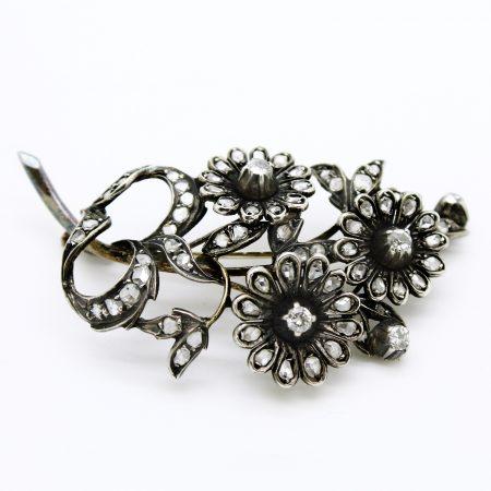 Spilla antica motivo floreale in oro argento e diamanti