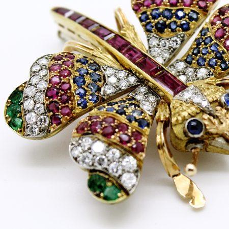 Spilla farfalla anni '70 firmata Cazzanica in oro giallo e bianco con rubini zaffiri smeraldi e diamanti
